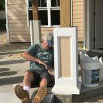 volunteer caulking at the Veterans Village