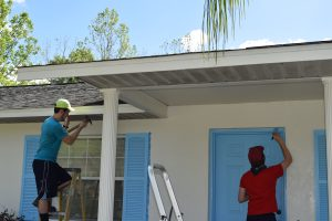 collegiate challenge volunteers painting at a preservation and repair project