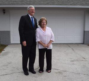 Congressman Daniel Webster with new homeowner in Leesburg