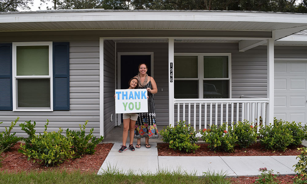 homeowner holding Thank You sign