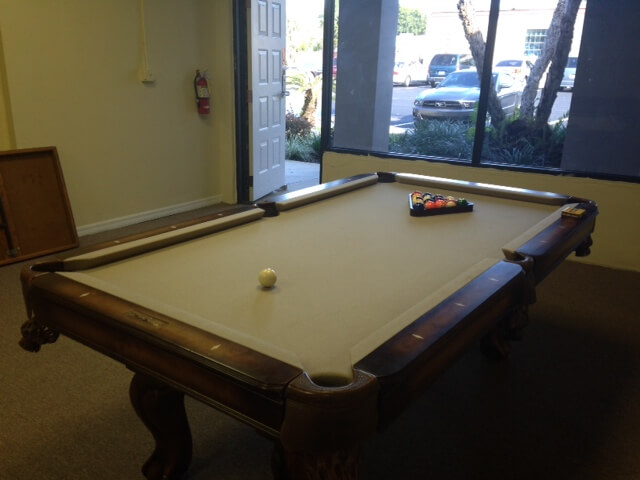 Pool table inside the game room at the DGV
