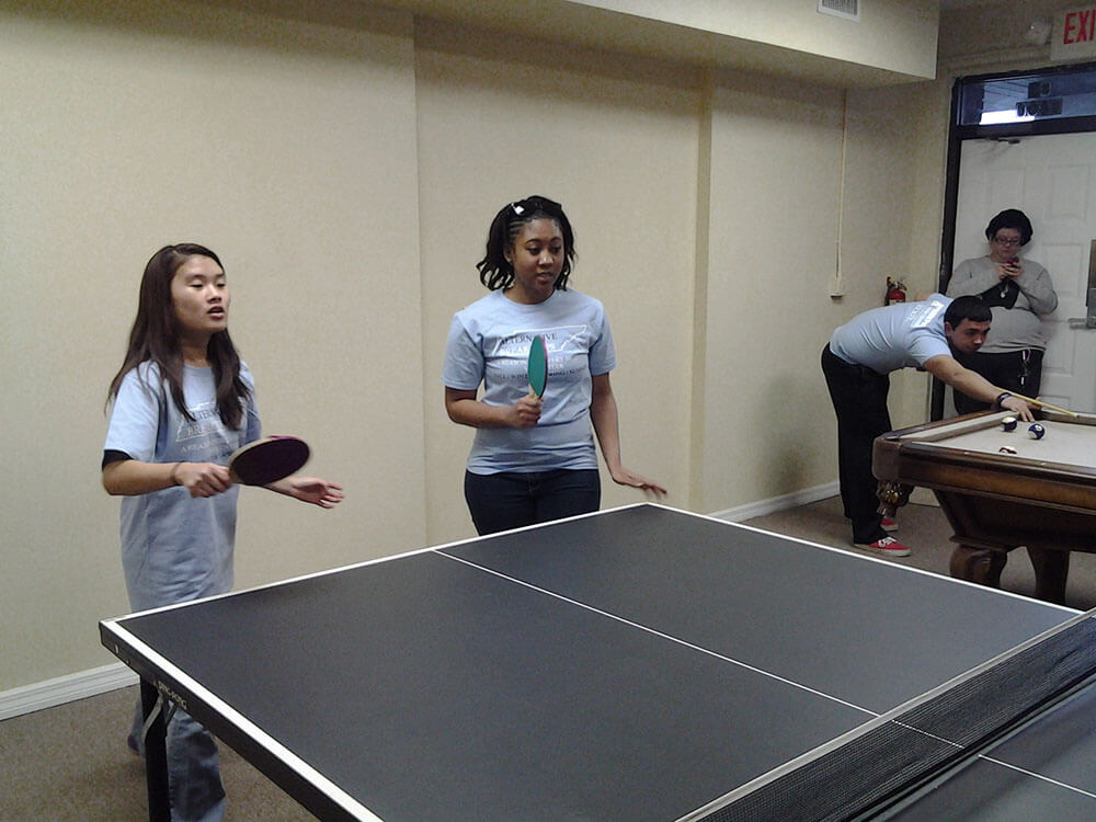 Volunteers playing in the game room at the DGV