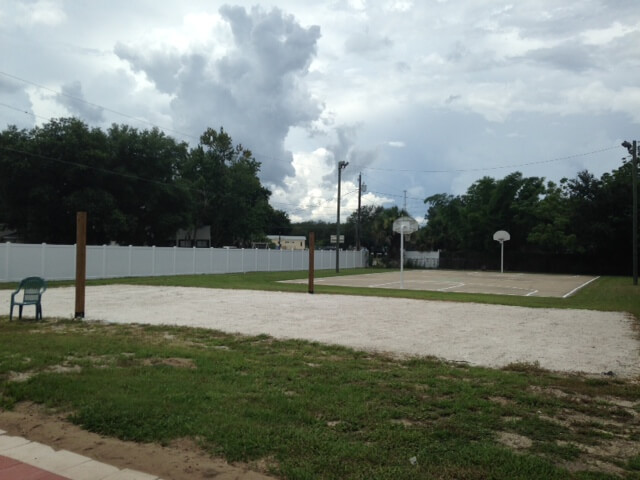 volleyball and basketball courts in the backyard of the DGV