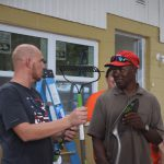 Habitat staff giving gift to homeowner
