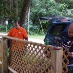 Home Depot volunteer and Habitat Lake-Sumter staff working on lattice