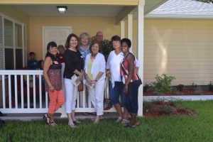 The Villages Home Decorating Club outside the Fruitland Park Habitat Lake-Sumter house with homeowner