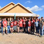 OSU volunteers at the Veterans Village with homeowners and other volunteers