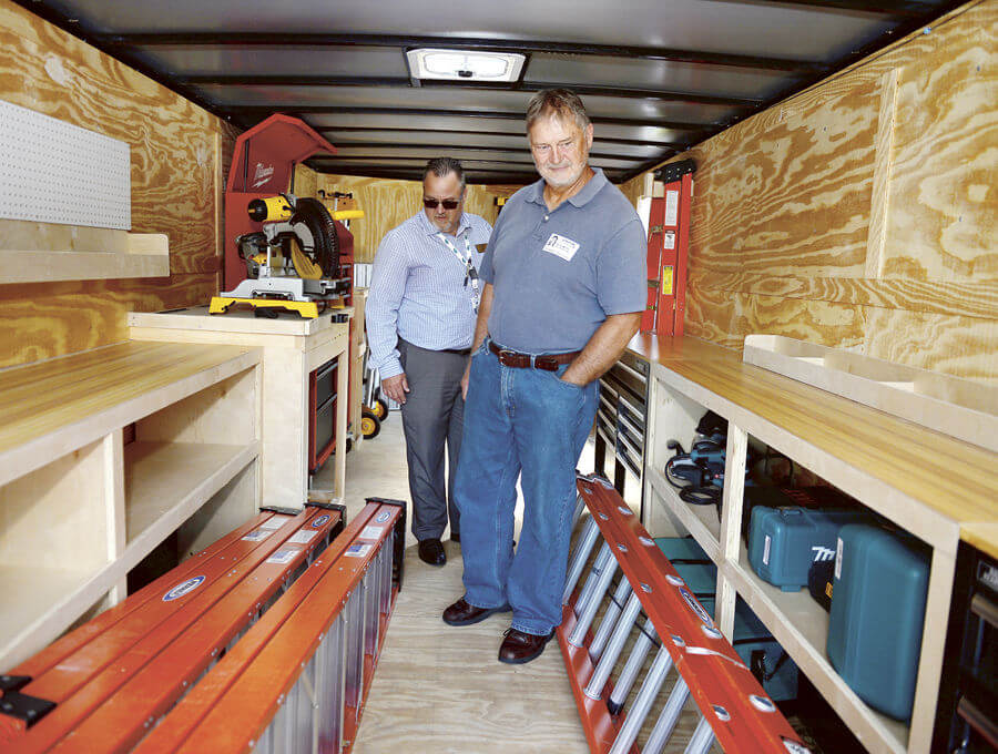 Habitat Lake-Sumter Construction Manager, Barry Martin giving tour of trailer