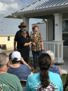 New Veterans Village homeowner with Rotarians