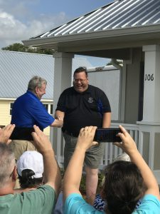 Board Chair Bill N. presents keys to new homeowner in the Veterans Village