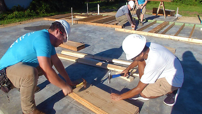 Students who are part of the inaugural senior class of the Youth Construction Academy, a new program Habitat for Humanity of Lake-Sumter, are learning how to build homes. (Sarah Panko, staff)