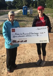 Rane Herzek ( Branch Manager at the Leesburg Wells Fargo) gave a check to our Director of Development Danielle Stroud. Thank you very much Wells Fargo!