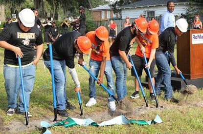 Leesburg High students put the shovels in the ground during groundbreaking ceremony for a joint project of Habitat for Humanity and Leesburg High School's Construction Academy on Monday, Aug. 26, 2019. Students will work alongside professionals to build a home for a family in need on 12th Street in Leesburg. (Rosemarie Dowell/Orlando Sentinel)