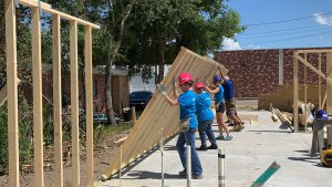 Women Build volunteers raising a wall in Eustis