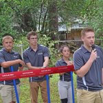 student introducing himself at the ground breaking