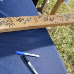 2x4 board signed by guests at ground breaking