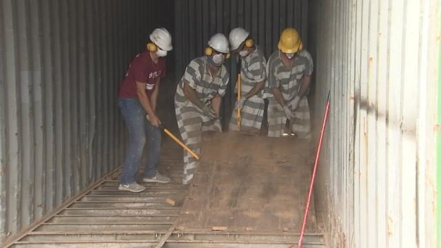 construction inter and inmates from the inmate construction academy converting containers to be shipped to the bahamas