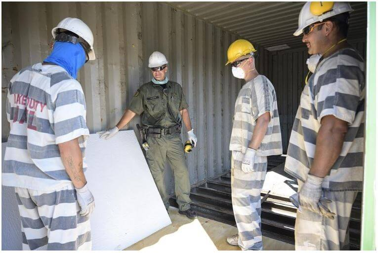Lake County Master Deputy Dave Wolniak works alongside inmates in the construction academy who are build housing units to send to the Bahamas [Cindy Sharp/Correspondent]