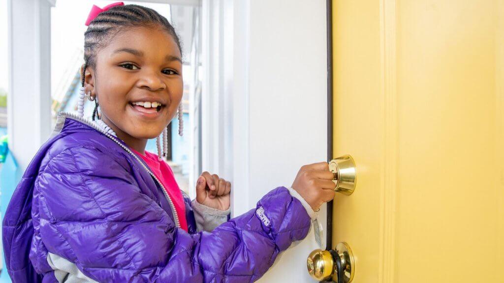 little girl opening door