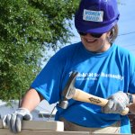 Eustis Site Women Build 2019 - smiling and hammering