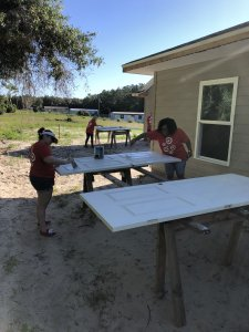 Oxford Site Women Build 2019 - Target Team Build painting doors outside
