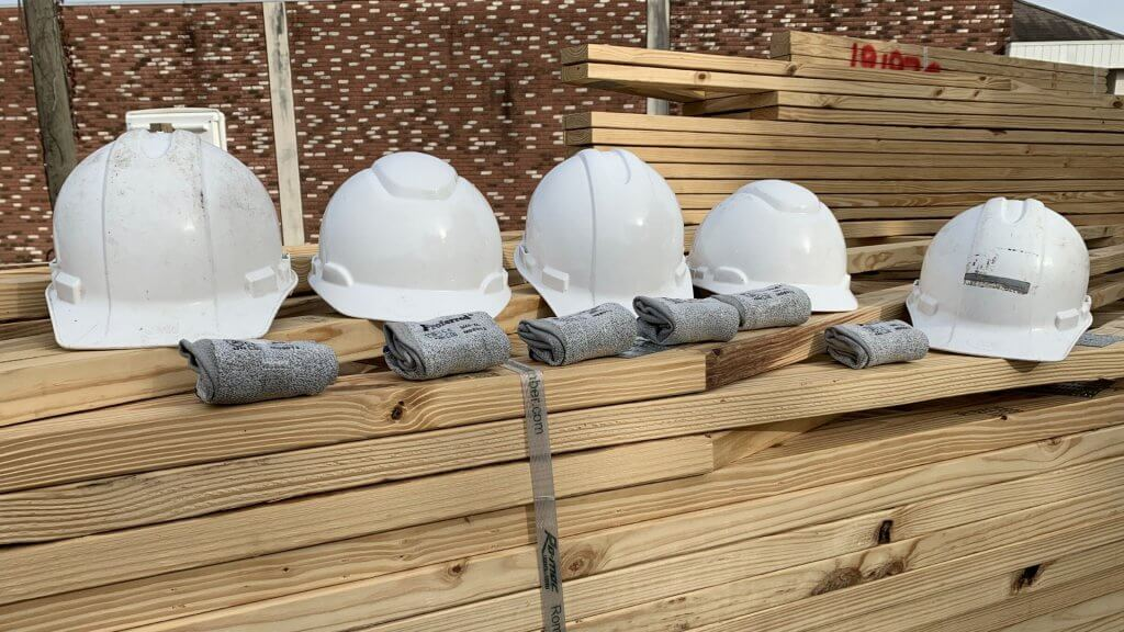 hard hats sitting on trusses