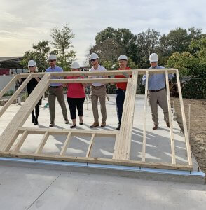 First National Bank of Mt. Dora raising first wall for new home in Eustis