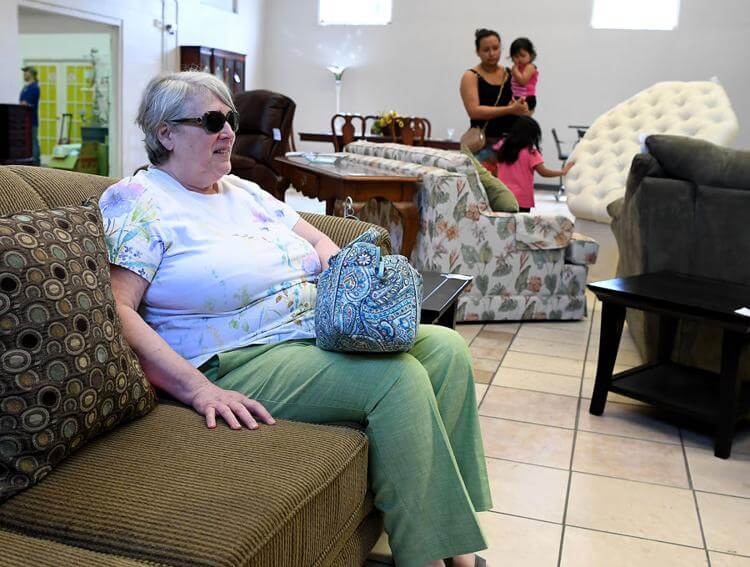 Ann Walls, of Virginia, tries out a couch while shopping at the Habitat for Humanity ReStore in Leesburg on Wednesday.  Michael Johnson, Daily Sun