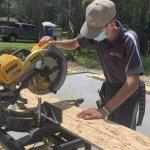 Nicholas using saw