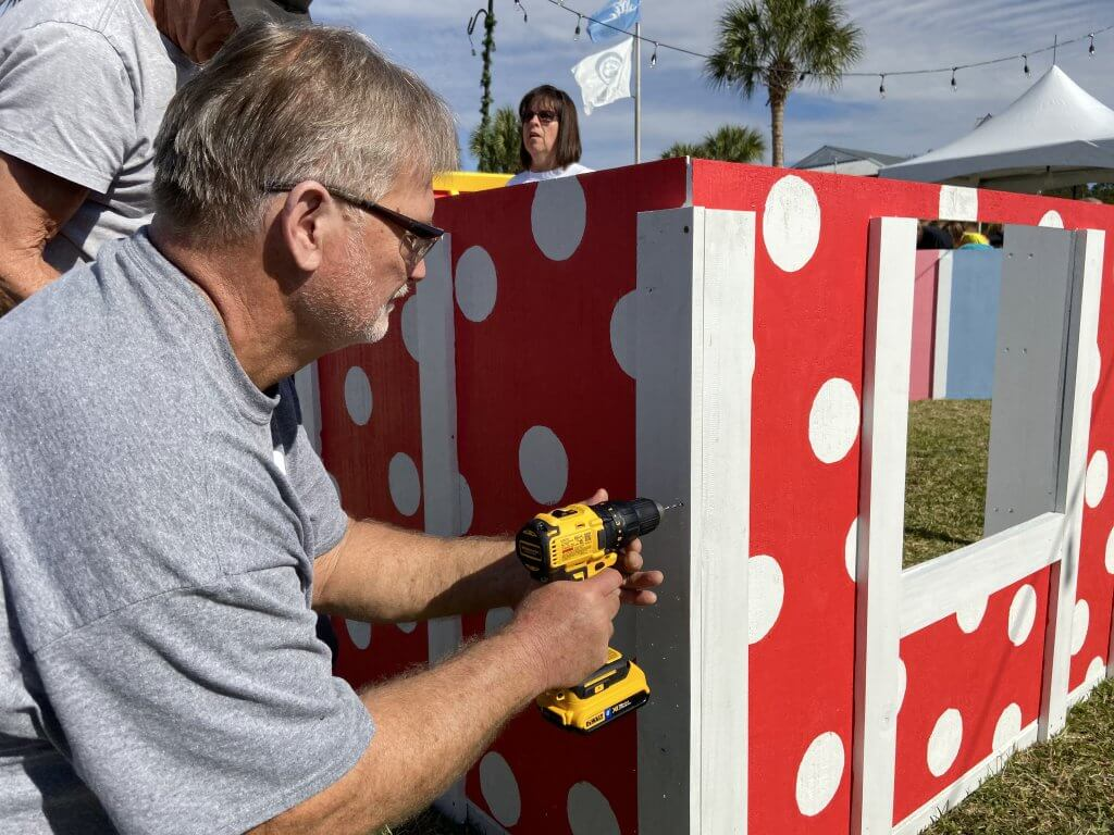 Construction Manager Barry Martin working on a playhouse at our first annual Jingle Build-Off