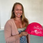 Danielle holding pink hard hat