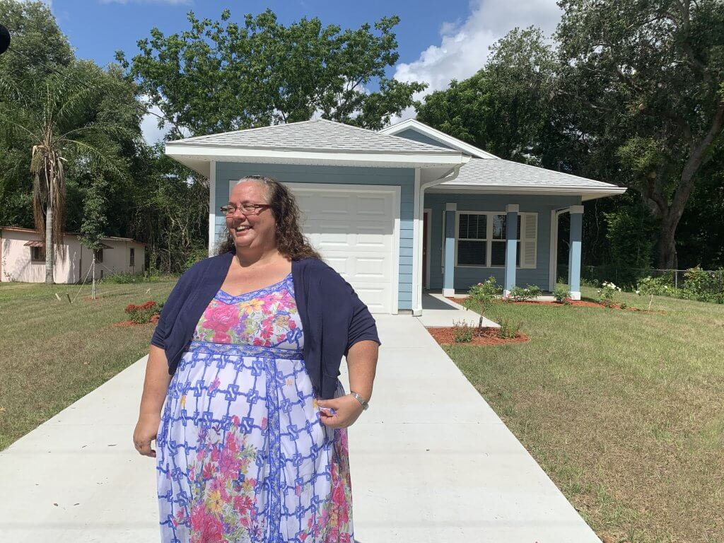 Joyce Tohill in front of Fruitland Park home