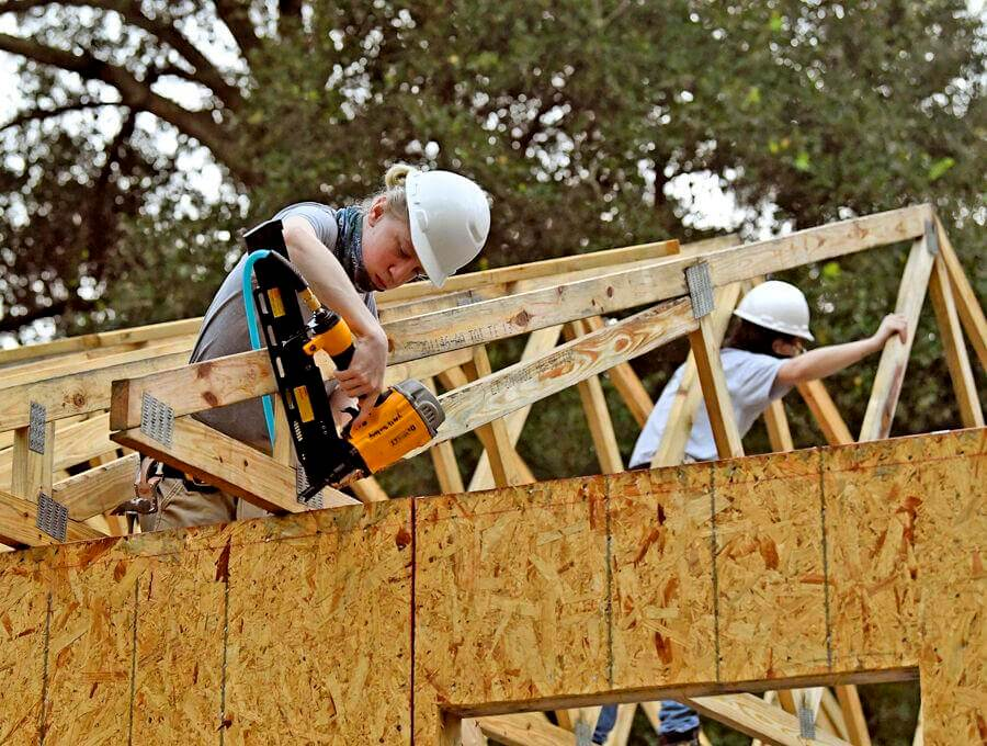 Jakobe Zick, a member of The Villages High School Construction Management Academy, nails a roof truss into place on a home being built for Habitat for Humanity Lake-Sumter in Lady Lake. The organization was named 2020 Non-Profit of the Year by the Lake County Chamber Alliance. George Horsford, Daily Sun